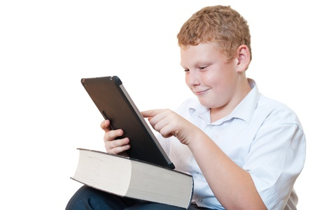 The boy with the book and tablet computer Stock Photo - 16217321