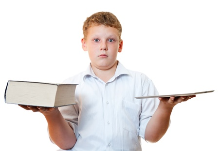 The boy with the book and tablet computer