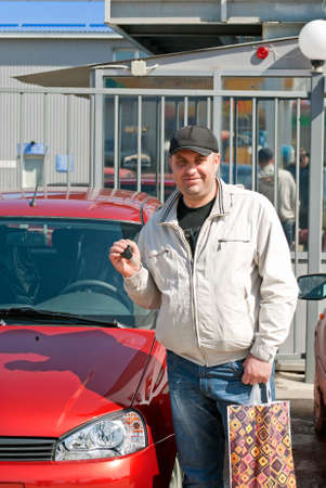 Man showing the keys to a new car photo