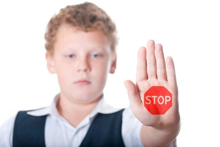 Boy shows stopping gesture Stock Photo