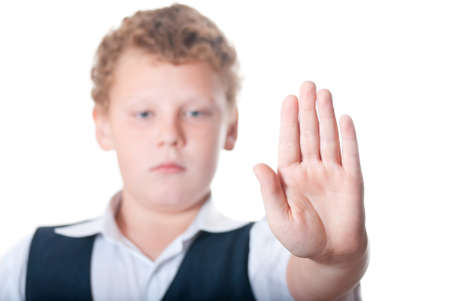 Boy shows stopping gesture photo