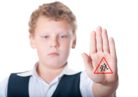 The boy shows the sign  Caution Children  photo