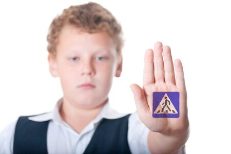 Boy shows shows the sign  pedestrian crossing  photo