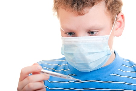 A boy in a protective mask with thermometer in hand Stock Photo - 18162381