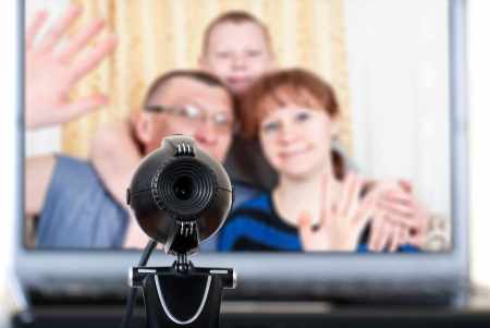 Family speaks on the video communications Stock Photo