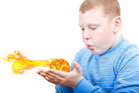 Boy blowing up the sun in the palms photo