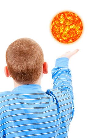 The boy tries to reach the sun photo