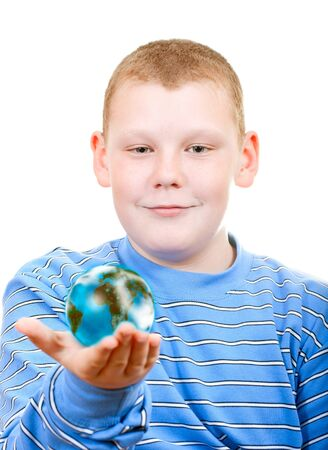 Boy holding a globe in the form of the planet photo