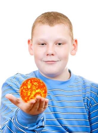 Boy holding a sun in the form of a star photo