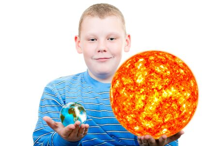 Boy holding the sun and the terrestrial globe