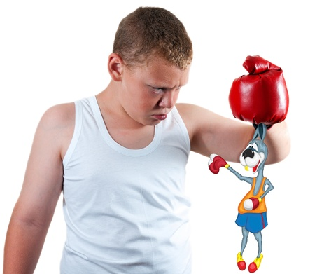 boy boxer keeps funny rabbit by the ears photo