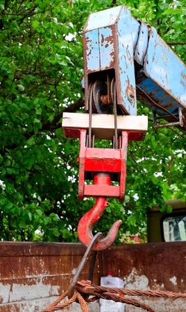 manipulator: red rusty old metal hook the manipulator