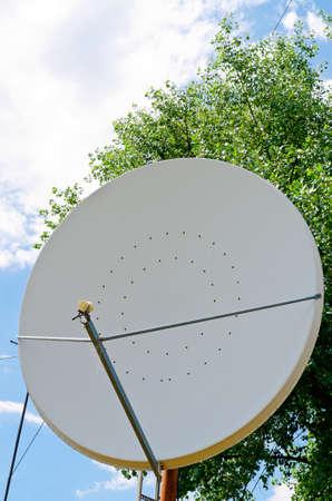 old satellite dish on blue sky background