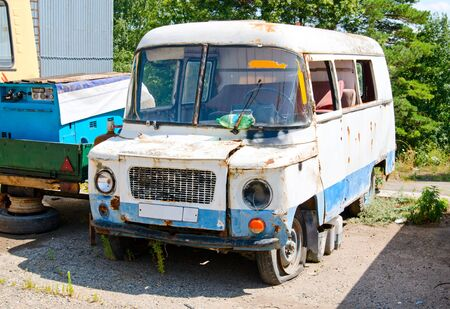 rusty old van in the parking lot