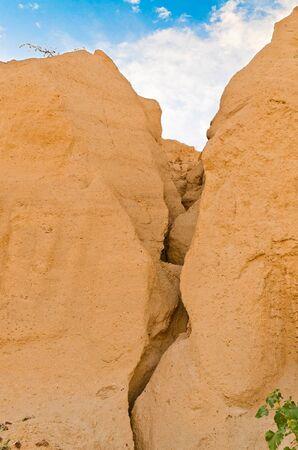 a large crack in the sandstone rocks