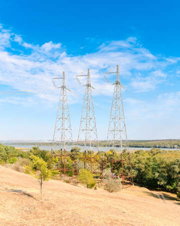 three iron supports for the transmission of electricity Stock Photo
