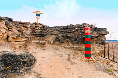 Border post of the Russian Federation and Orthodox memorial cross