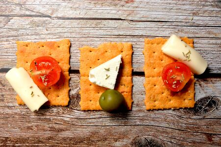 savory craker snack cookies with tomato and cheese