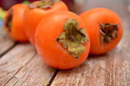 lotus persimmon sweet orange fruit on wooden table