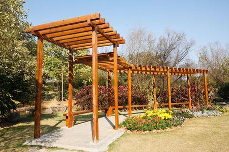 a wooden corridor in a park Stock Photo