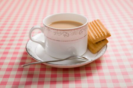 cup of tea: a cup of tea on a table Stock Photo