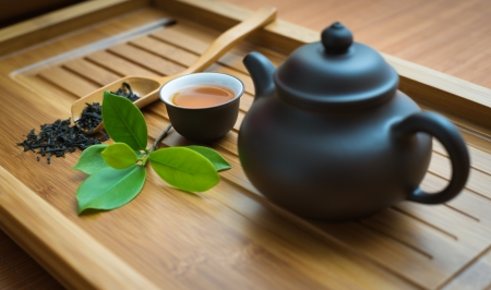 tealeaves,teacup and teapot on the bamboo mat