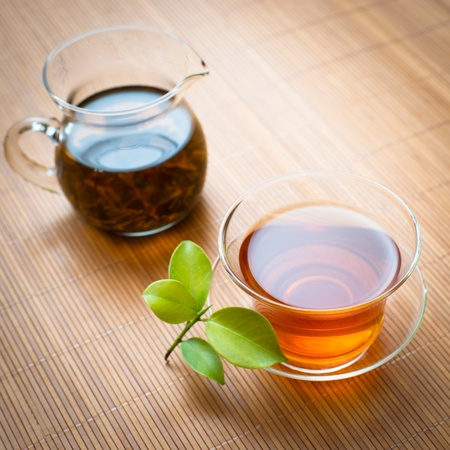 bamboo mat: black tea on a bamboo mat Stock Photo