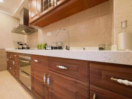 the kitchen with classic cabinet