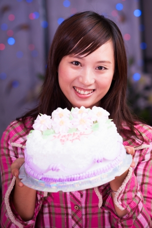 cream cake: asian girl with a cream cake at birthday party