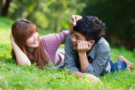 young couple smiling: happiness young couple in the park