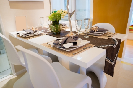 dining room interior: the tableware on dining table Stock Photo