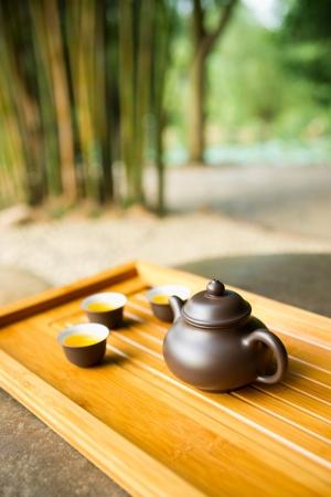 bamboo mat: teapot and teacup on a bamboo mat