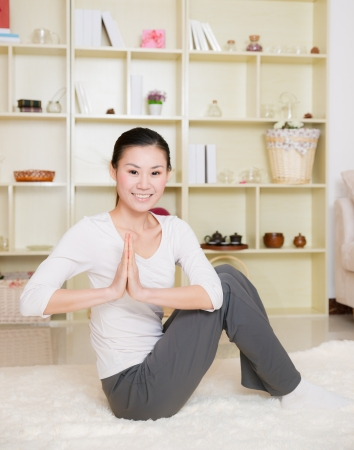 heathy: chinese woman doing yoga at home