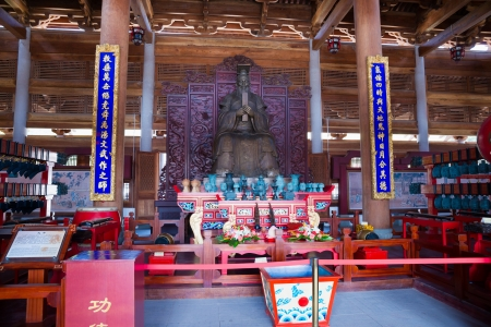 confucian: Nanning, China - Oct 21, 2012:Confucius statue in Hall of Great Achievements in Confucian temple.Confucius is the greatest educator in Chinese history,Chinese people built mamy Confucian temple to memorial him,and also pray for a good fortune in here