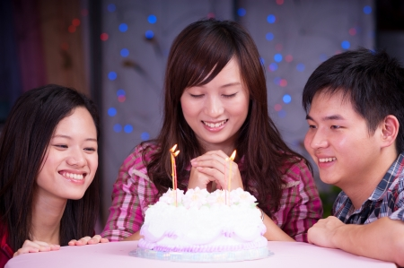 chinese adult: young asian friends at birthday party