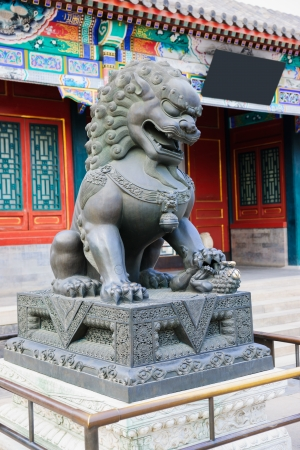 royals: bronze lion sculpture in Wenchang court in Summer Palace.Summer Palace is a very famous tourist place in Beijing,China.it was built during 1750-1764,it is the  largest ancient  Royal garden in the world,in the Qing Dynasty,the Royals relaxed in Summer Pal