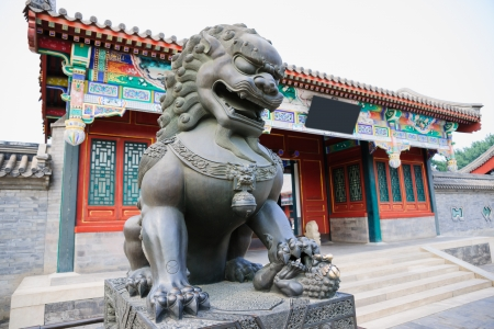 summer palace: bronze lion sculpture in Wenchang court in Summer Palace.Summer Palace is a very famous tourist place in Beijing,China.it was built during 1750-1764,it is the  largest ancient  Royal garden in the world,in the Qing Dynasty,the Royals relaxed in Summer Pal