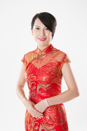 chinese dress: Chinese woman in cheongsam isolated on white background