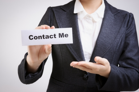 business contact: business woman with a paper card with  contact me  on it
