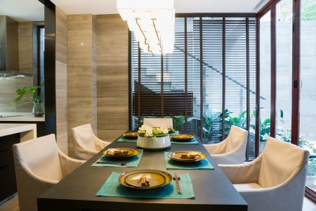 dining table and chairs: dining room with nice decoration Stock Photo