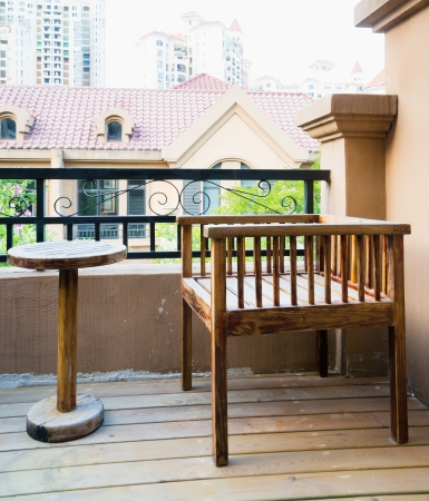 porches: chair and table for relaxation on patio outside the door