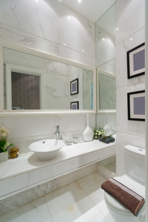 mirror on wall: the sink and mirror in a modern bathroom Stock Photo