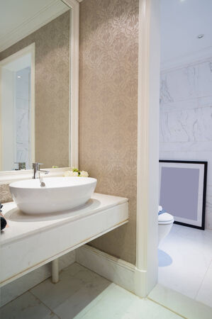 mirror on wall: modern bathroom with sink and mirror