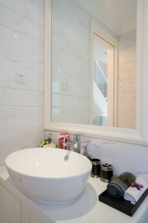 the sink and mirror in a modern bathroom Stock Photo - 24283099