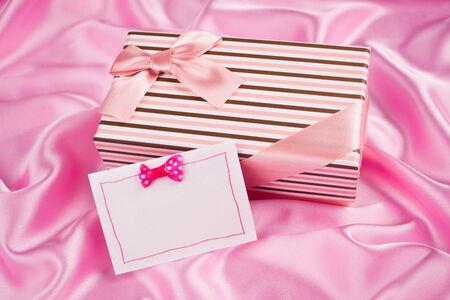 silk cloth: nice gift box and card on pink silk cloth