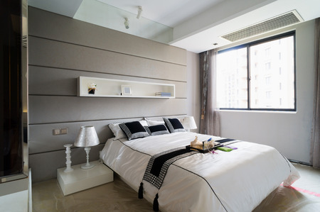 bed frame: modern bedroom with nice decoration Stock Photo