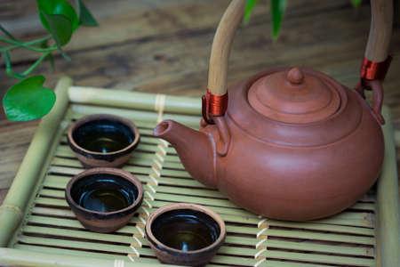 bamboo mat: closeup chinese teapot and teacup on bamboo mat