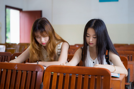schoolmate: Asian female college students to study in classroom