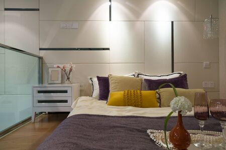 bedding indoors: modern bedroom with nice decoration Stock Photo
