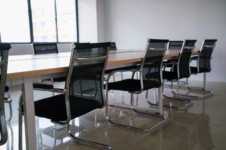 empty conference room with board room table and chairs